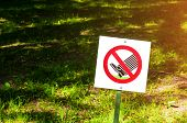 The Prohibitive Sign On The Label Do Not Walk The Lawn - Closeup Against Tha Lawn In Sunlight. Close poster