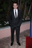 LOS ANGELES - DEC 01:  Anton Yelchin arrives to the Beat The Odds Award 2011  on December 01, 2011 in.Beverly Hills, CA.