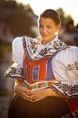 Keeping tradition alive: young woman in a richly decorated ceremonial folk dress/regional costume (K