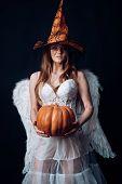Halloween People In Angel Costume. Happy Halloween Angelic Witch. Halloween Party Girl. Beauty Hallo poster