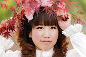 picture of lolita  - japanese lolita portrait in park during fall season - JPG