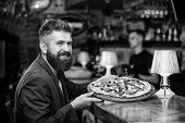 Hipster Client Sit At Bar Counter. Man Received Delicious Pizza. Enjoy Your Meal. Cheat Meal Concept poster