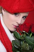 portrait of gorgeous blonde with red roses and assorted clothes