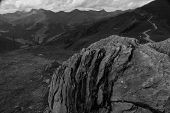 Mountain Path In Black And White With Rock Formation In Foreground