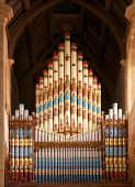 stock photo of pipe organ  - vertical church organ pipes in a cathedral - JPG