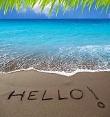 Brown sand beach with written word Hello in Canary Islands