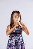 Little girl playing music with a flute