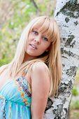 foto of barrel racing  - young beautiful woman in a park near a birch - JPG