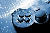 stock photo of peripherals  - Game controller and  blue light - JPG