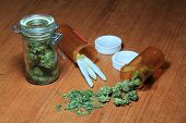 image of marijuana plant  - Medical Marijuana in pill bottles - JPG