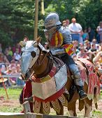 stock photo of jousting  - knight preparing for a joust at a rennaissance fair - JPG