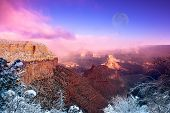 A dramatic winter image of the Grand Canyon shot at the Bright Angel Village overlook at the South R