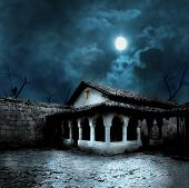 picture of scary haunted  - Halloween pumpkins in the yard of an old house at night in the bright moonlight - JPG