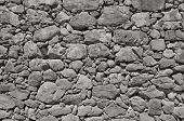Dark Grey Old Wall Made Of Big And Little Stones