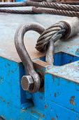pic of shackles  - Close up heavy duty bolt anchor shackle and wire rope sling on crane counter weight - JPG
