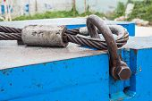 stock photo of shackles  - Close up heavy duty bolt anchor shackle and wire rope sling on crane counter weight - JPG