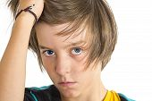 Serious Teen Boy, One Hand In His Hair, Isolated On White