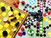foto of chessboard  - Board games are carelessly strewn across the table - JPG