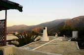Mountains Over Moorish Roof At Dusk