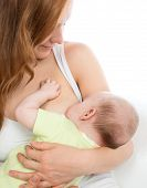 stock photo of child feeding  - Mother breast feeding child baby boy with milk on a white background - JPG