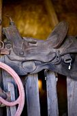 foto of western saddle  - Saddle on a Wood Fence - JPG