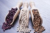 pic of pinto bean  - Close up photo of a beans in wooden scoop  - JPG