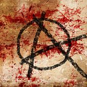 stock photo of anarchists  - anarchy symbol on an old grunge wall background - JPG