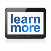 Education concept: Learn More on tablet pc computer