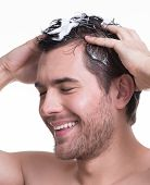 Young Happy Smiling Man Washing Hair.