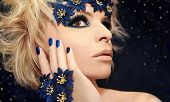 Luxurious blue manicure and makeup.