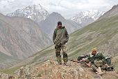 JAMMU AND KASHMIR, INDIA - JULY 17, 2006: Indian Army uniformed personnel in Kashmir Himalayas mount