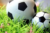 foto of underdog  - soccer balls, toys, symbol image, different sizes
