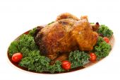 stock photo of roast chicken  - A spicy whole roast chicken on a platter - JPG