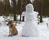 Sculpture Of A Woman Made Of Snow In The Forest Park
