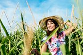 Beautiful Female Farmer In Corn Field