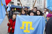 Family holding Crimean Flag