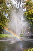 Fountain With Rainbow In The Park Of Czestochowa