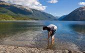 Boy walks in clear lake