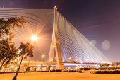 The Rama VIII bridge at night in Bangkok Thailand