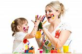 Mother With Child Paint And Have Fun Pastime