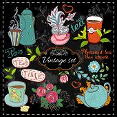foto of teapot  - Set of tea collection with a tea cup and flowers in vintage style stylized drawing with chalk on blackboard - JPG