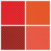 Seamless vector patterns or textures set with white polka dots on red, orange, brown background