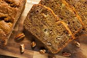 stock photo of fresh slice bread  - Homemade Banana Nut Bread Cut into Slices - JPG