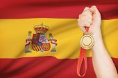 Medal In Hand With Flag On Background - Kingdom Of Spain