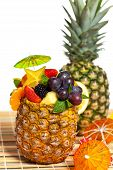 Fresh Fruit Salad in a Pineapple. Selective focus.