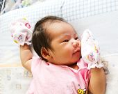 Newborn Asian Baby Girl Lies On A Blanket