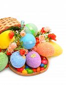 Easter Colored Plastic Eggs, Flowers And Caramels In The Basket