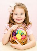 Cute Little Girl With Basket Full Of Colorful Easter Eggs