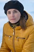 image of beret  - Woman in black beret and a yellow jacket - JPG