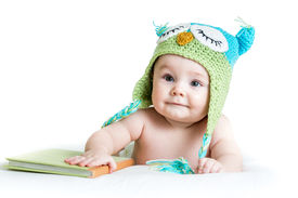 foto of owl eyes  - baby in funny owl knitted hat owl with book on white background - JPG